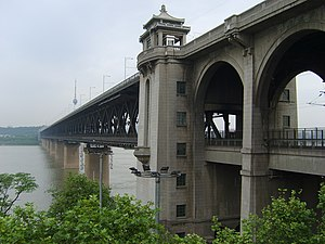 Beijing–Guangzhou Railway - The Wuhan Yangtze River Bridge, built in 1957, connected the Beijing-Hankou Railway and Guangzhou-Wuchang Railways to form the Jingguang Railway.
