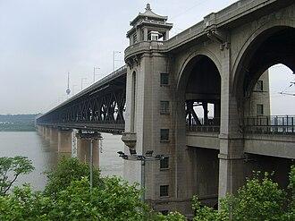 Beijing–Guangzhou Railway - The Wuhan Yangtze River Bridge, built in 1957, connected the Beijing-Hankou Railway and Guangzhou-Wuchang Railways to form the Jingguang Railway.