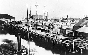 Puget Sound mosquito fleet - Yesler, Crawford and other wharves in 1882, with number of steamers visible, including ''Teaser'' in foreground