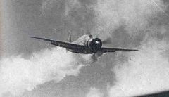 Lt Yamaguchi's Yokosuka D4Y3 (Type 33) Suisei diving at USS Essex, November 25, 1944. The dive brakes are extended and the non-self-sealing port wing tank is trailing fuel vapor and/or smoke.
