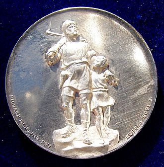 Richard Kissling - Zürich 1893 Cantonal Shooting Festival Silver Medal, obverse. It shows the design of Kissling's William Tell Monument in Altdorf.
