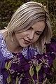 День Вишиванки. Молода україночка у вишитій синій сукні серед квітів 18.jpg