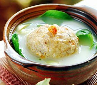 "Chinese cuisine - Xièfěn shīzi tóu or ""lion's head with crab meat"" is a traditional meatball soup from Jiangsu, East China. Crab roes are embedded in the top as decoration."