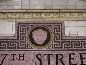 137th Street–City College (IRT Broadway–Seventh Avenue Line) - Cartouche with three faces