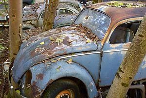 Historic car wreck on car cemetery in Kaufdorf...