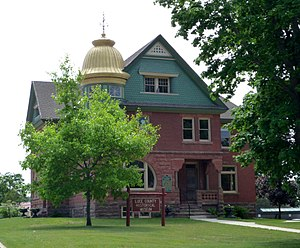 Newberry, Michigan - The Luce County Historical Museum is housed in the historic, 1894 sheriff's house and county jail. In the 1970s, historic preservationists lost a fight to preserve county's elaborate courthouse; however its fountain was moved to the front of the museum.