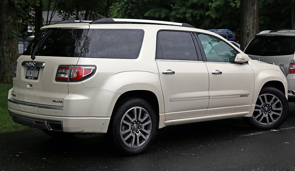 english rear right view of 2013 gmc acadia denali badly and rudely. Black Bedroom Furniture Sets. Home Design Ideas