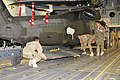 25th CAB loads helicopters on planes 120924-A-UG106-191.jpg