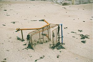 Shopping cart on the beach, St. Andrews, Scotland