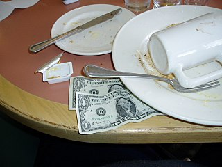 Leaving some small change on a restaurant table is a common way of giving a tip to the serving staff.