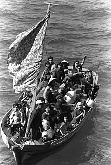 Refugees crowded together on a boat