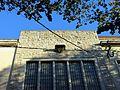 558 Fàbrica al c. Joan Bruguera, 10 (Girona), peanya de Sant Eloi.jpg