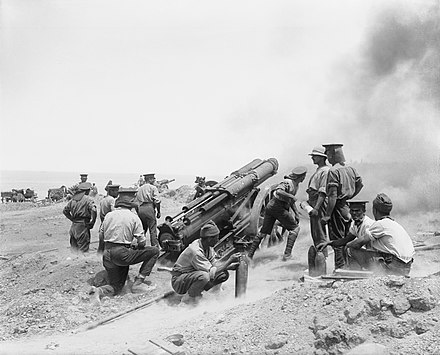 A British 60-pounder (5-inch (130 mm)) gun at full recoil, in action during the Battle of Gallipoli, 1915. Photo by Ernest Brooks. 60 pounder Cape Helles June 1915.jpg