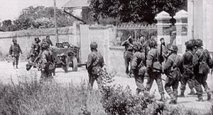 Battle of Merville Gun Battery - Men of the 9th Parachute Battalion marching through Amfreville later in the month