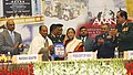 A. K. Antony presenting the first released copy of the commemorative brochure to the President, Smt. Pratibha Devisingh Patil, on the occasion of inauguration of Corps of Signals Centenary year, in New Delhi.jpg