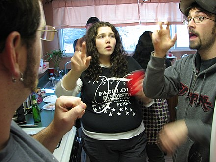 Two men and a woman signing American Sign Language (2008)