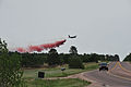 A U.S. Air Force C-130 Hercules aircraft with the 302nd Airlift Wing helps put out wildfires with a Modular Airborne Firefighting System in El Paso County, Colo., June 13, 2013 130613-Z-WF656-014.jpg