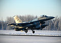 A U.S. Air Force F-16 Fighting Falcon aircraft assigned to the 18th Aggressor Squadron takes off from Eielson Air Force Base in Alaska Feb. 10, 2014, en route to Andersen Air Force Base in Guam to support 140210-F-FT438-009.jpg