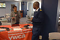 A U.S. Coast Guardsman, right, speaks to an exhibitor during the Coast Guard Community Volunteer Fair at Coast Guard headquarters in Washington, D.C., April 23, 2013 130423-G-OY189-080.jpg