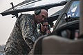 A U.S. Soldier assigned to the 4th Squadron, 6th Cavalry Regiment, 16th Combat Aviation Brigade, 2nd Infantry Division briefs Chief of Staff of the Army Gen. Raymond T. Odierno, left, about an AH-64D Apache 140224-A-KH856-465.jpg