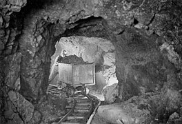A miner hauling a car of silver radium ore, 340 feet below the surface, Eldorado Mine of Great Bear Lake.jpg