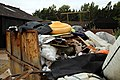A rusty skip overfull at Hatfield Broad Oak Essex England.JPG