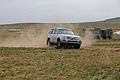A sport utility vehicle loses control after running over a vehicle lightweight arresting device during a demonstration at the Five Hills Training Area in Mongolia Aug. 26, 2013, during the Non-Lethal Weapons 130826-M-MG222-019.jpg