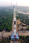 A view of GSLV-F08 vehicle on the Mobile Launch Pedestal proceeding towards the Umbilical Tower seen the background.jpg