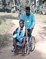 A wheel chair bound voter arrives for voting, at a polling booth, in Sukma, during the 1st phase of Chhattisgarh Assembly Election, on November 12, 2018.JPG