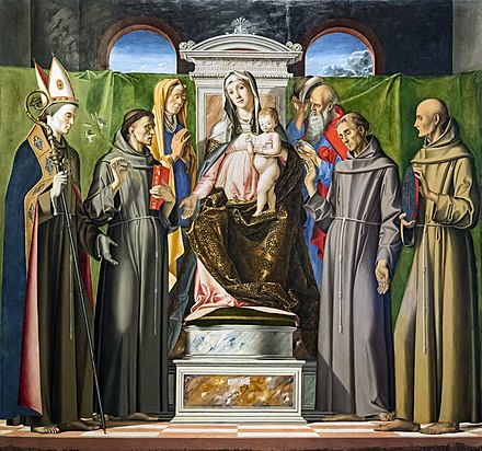 In Alvise Vivarini's painting, Anthony is distinguished from the other saints by his attributes: the book and the white lily stalk. Accademia - Madonna in trono con il Bambino tra i santi Anna, Gioachino, Ludovico da Tolosa, Antoinio da Padova, Francesco et Bernardino da Siena - Alvise Vivarini Cat607.jpg