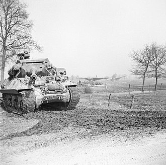 17pdr SP Achilles - Crossing the Rhine 24–31 March 1945: An Achilles self-propelled anti-tank gun on the east bank of the Rhine moves up to link with airborne forces whose abandoned Horsa gliders can be seen in the background. 26 March 1945