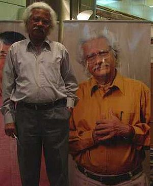 Adoor Gopalakrishnan - Adoor standing next to his portrait