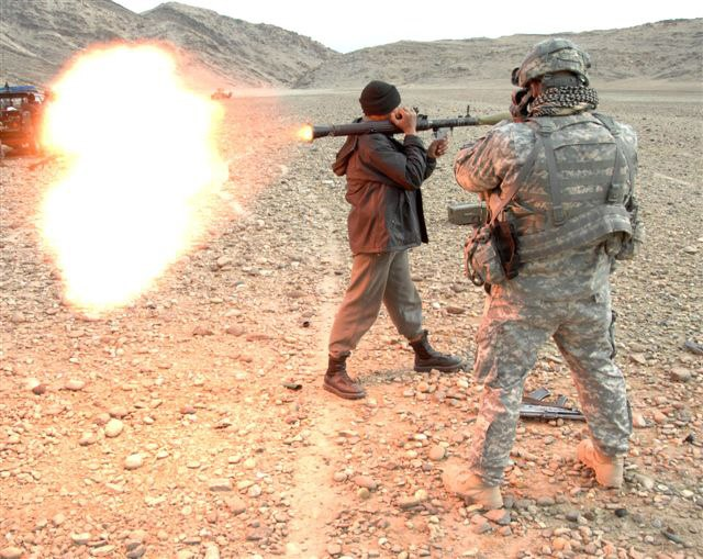Afghan National Police officer fires an RPG round at a special mission conducted by US Army