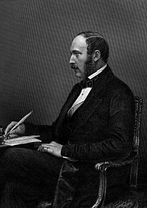 Frock coat - Prince Albert wearing a black frock coat with silk-faced lapels, and bow tie