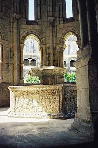 Alcobaça, Portugal - Gothic fountain house and renaissance water basin in the cloister of the Alcobaça Monastery.