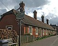 Almshouses, High Street, Much Hadham, with village sign. - geograph.org.uk - 144781.jpg