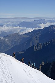 Climbers descending a ridge.