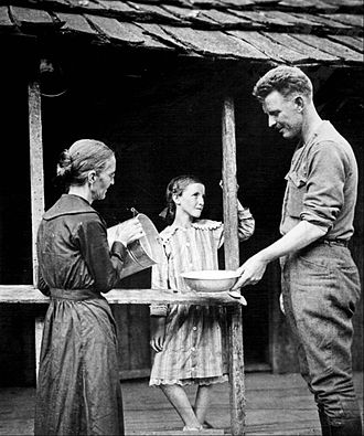 Alvin York - U.S. Army Sergeant Alvin C. York after his return to his Tennessee home. His mother is pouring water into the basin and his younger sister is standing on the cabin's back porch. York turned down many lucrative offers, including one worth $30,000 to appear in vaudeville, to return to the life he had known before the war.