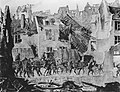 American troops entering a village in pursuit of the enemy during the advance across the Marne, July 13, 1918.jpg