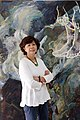 "Ann Phong in front of her painting ""Jump"".jpg"