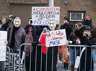 Anonymity - Protesters outside a Scientology center on February 10, 2008, donning masks, scarves, hoods, and sunglasses to obscure their faces, and gloves and long sleeves to protect them from leaving fingerprints.