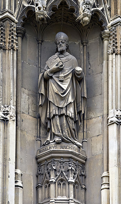 The statue of Anselm on the southwest porch of Canterbury Cathedral, holding a copy of Cur Deus Homo in its right hand Anselmstatuecanterburycathedraloutside.jpg