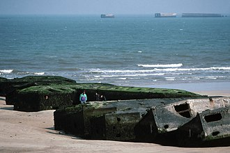 Operation Overlord - Remains of Mulberry harbour B at Arromanches-les-Bains (Gold) as seen in 1990