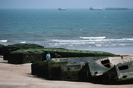 Remains of Mulberry harbour B at Arromanches-les-Bains (Gold) as seen in 1990 Arromanches Mulberry-Harbour Beetle-Pontoons 1 90.jpg