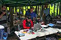 At the Bc Orienteering Championships on Sumas Mountain in the Fraser Valley - more busy bees around the officials tent - Magnus at the computer - (28606787346).jpg