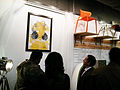 Attendees of winter exhibition titled ENCORE take in art work of Tuface.jpg