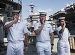 Australian sailors sounding boatswain's pipes on board HMAS Success in July 2018.jpg