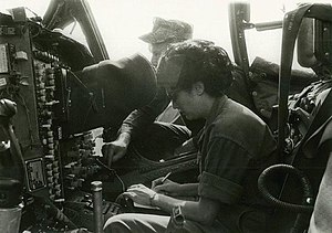 Beverly Deepe Keever - Beverly Deepe Keever with USMC UMA (aco) 242 Sqd of A-6 Intruder out of Danang Airbasse March 12, 1967 with Bomber/Navigator explaining all the electronic gadgets – for Cosmopolitan piece on USMC (which was later published; this photo was not submitted)