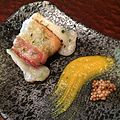 Bacon-wrapped mochi, spicy mustard, and pickled mustard seeds. (14179283046).jpg