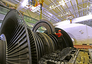 Steam turbine - A low-pressure steam turbine in a nuclear power plant. These turbines exhaust steam at a pressure below atmospheric.